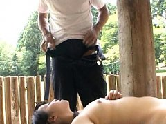 Japanese AV Model is doggy pumped behind a wood in...