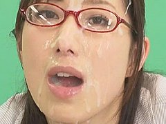News girl endures rain of bukkake semen shots on t...