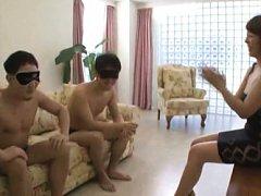 Misa Yuki Asian in sexy dress plays with hunks wea...
