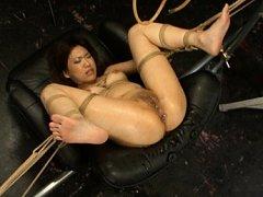 Mari Kamiya has her legs spread wide and ass playe...