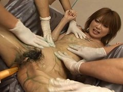 Rika Sakurai Asian model is covered in sticky sauc...