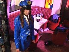 Asuka Sawaguchi with latex police uniform giving b...