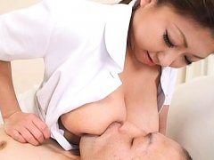 Suzuka Arinaga Asian nurse feeds patient with her...