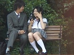 Saori Hara Asian student sits on the bench and has...