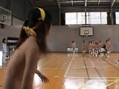 Amateur teens line up on the basketball court for...