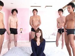 Busty Yuma Asami is ready to suck five cocks in th...