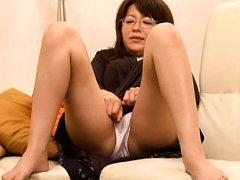 Japanese AV Model with specs rubs her clit and wan...