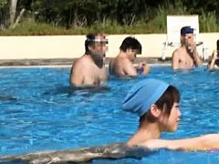 Japanese AV Model loses her swimming suit in pool...