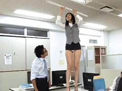 Japanese AV Model shows ass out of skirt at office...