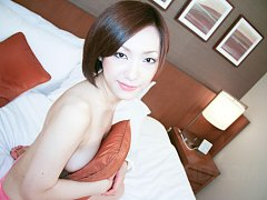 Fresh faced Nene Iino shows off her tits with a fa...