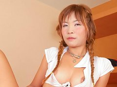Toy Asian chick with specs and pigtails has mouth...