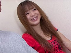 Noriko Kago Asian doll in red t-shirt takes care o...