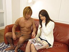 Satomi Kirihara in short jeans and sweater licks a...