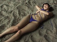 Miyu Takahashi Asian in mauve bath suit plays in t...