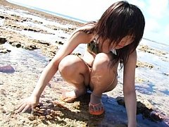 Yoshiko Suenaga Asian in sexy bath suit is playful...