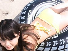 Ai Okawa Asian doll in yellow bath suit plays so s...