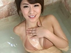 Chika Tono Asian spoils her sexy body in water and...