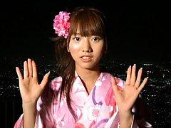 Aki Takajo Asian in geisha dress admires the city...