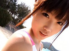 Aira Mihana Asian in swiming suit sits with head o...