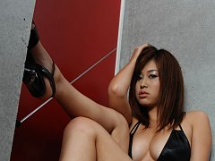Sexy asian babe sizzles in her black one piece swi...