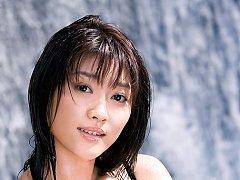 Sweet little asian hottie showing her perky breats...