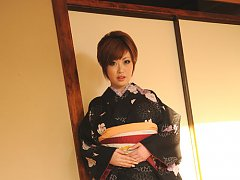 Short haired asian model in a kimono with large so...