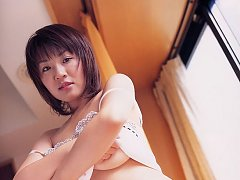 Busty asian beauty can barely hold her melons in l...