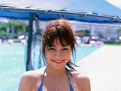 Captivating gravure idol shows off in her bikini a...