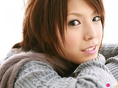 Hitomi Oda Asian shows nice cleavage on sweater an...