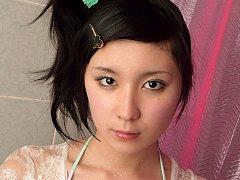 Gorgeous asian angel in sensual green lingerie tak...