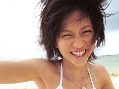 Misako Yasuda Asian in bath suit relaxes in water...