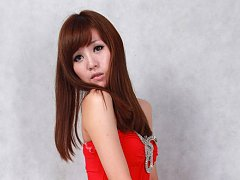 Sandy Asian on heels shows hot behind in red dress...