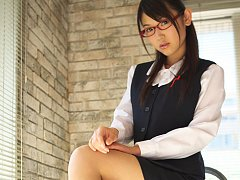 Noriko Kijima Asian with specs and office suit is...