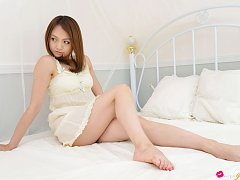 Rina Itoh Asian honey plays with her sexy lingerie...