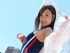 Kana Yuuki Asian in bath suit plays with umbrella...