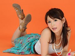 Yumi Asian honey on heels and with big eyes is ele...