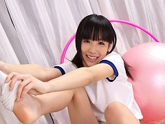Yuri Hamada Asian in sports equipment plays with b...