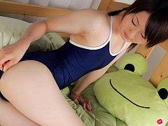 Naoko Sawano Asian in bath suit puts pillow betwee...
