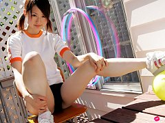 Naoko Sawano Asian in sports outfit plays with bal...
