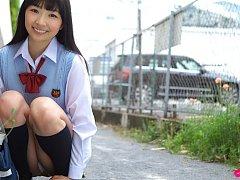 Kotone Moriyama Asian in uniform bends and shows a...