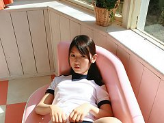 Noriko Kijima Asian in sports equipment is playful...