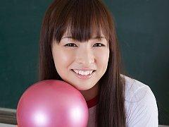 Maho Kiruma Asian in sports equipment plays with b...