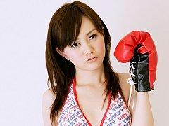 Enticing asian beauty in a cute bikini and boxing...