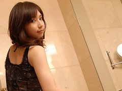 Kaori Ishii gets all wet in the shower while weari...