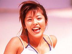 Stacked gravure idol babe in a blue bikini jumping...