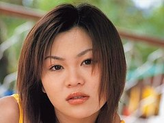 Cute short haired asian chick modeling in her biki...