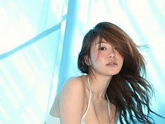Beautiful asian chick with big bouncy boobs in a t...