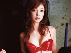 Sultry gravure model seduces with her hot red leat...