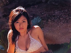 Flirtatious asian idol with large melons spilling...