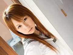 Beautiful asian school girl slowly takes off her u...
